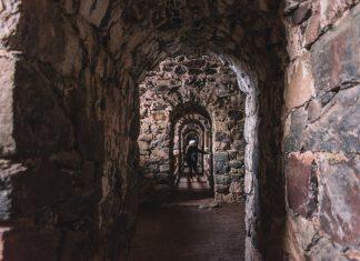 Woman walking in Suomenlinna Sea Fortress in Helsinki