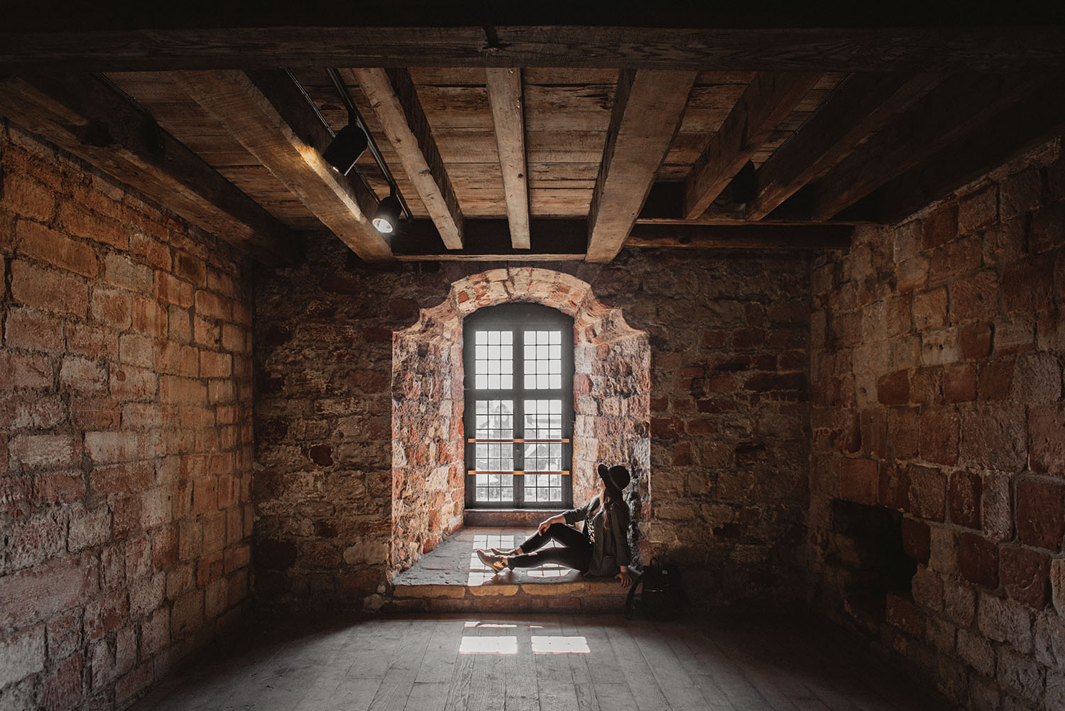Woman sitting in window in Carlisle Castle