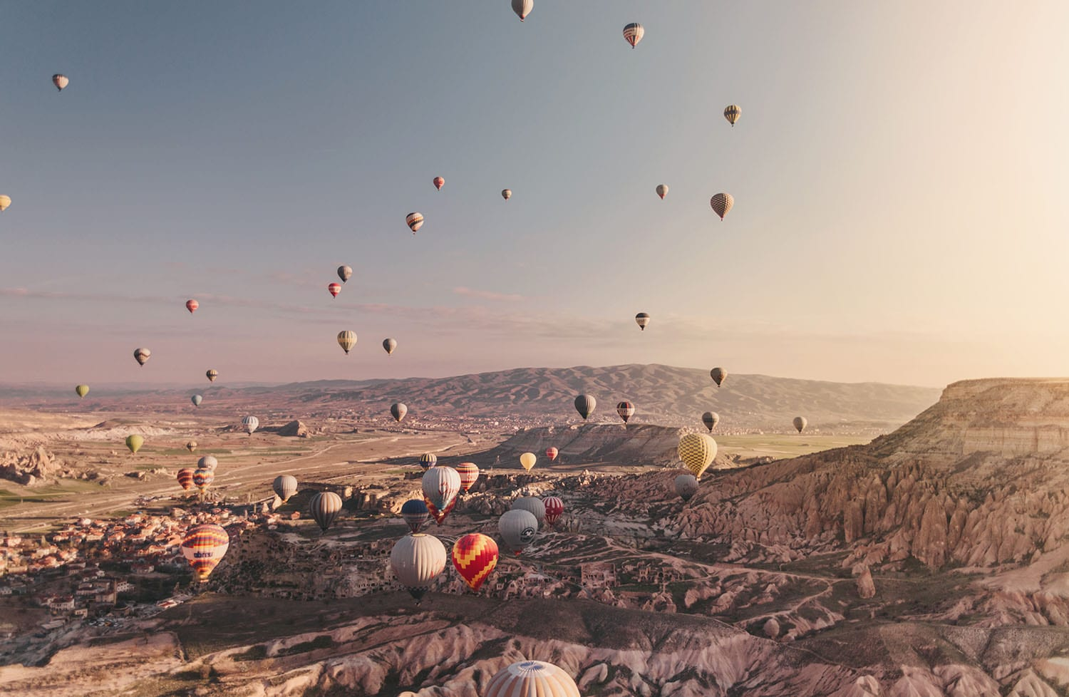 Surreal view: Hot air balloons in beautiful sunrise in Cappadocia, Turkey
