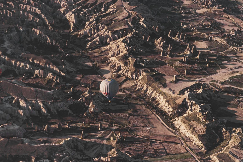 Hot air balloon flying over Cappadocia's beautiful landscape