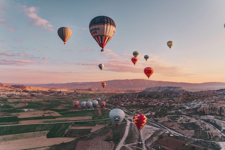 Hot air balloons in magical sunrise in Cappadocia, Turkey