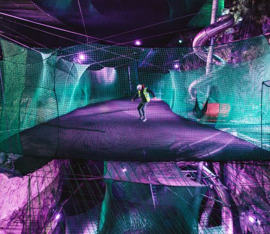 Man bouncing in Bounce Below - Underground Trampolines in North Wales