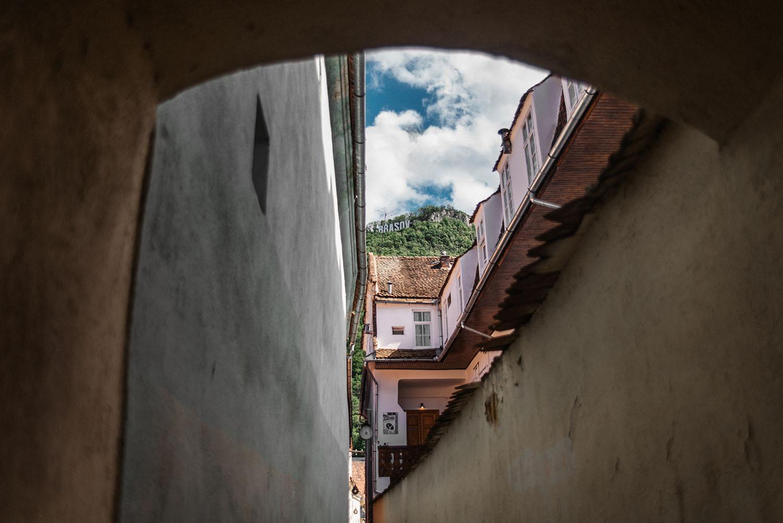 Strada Sforii, one of the narrowest street in the city of Brașov, Romania