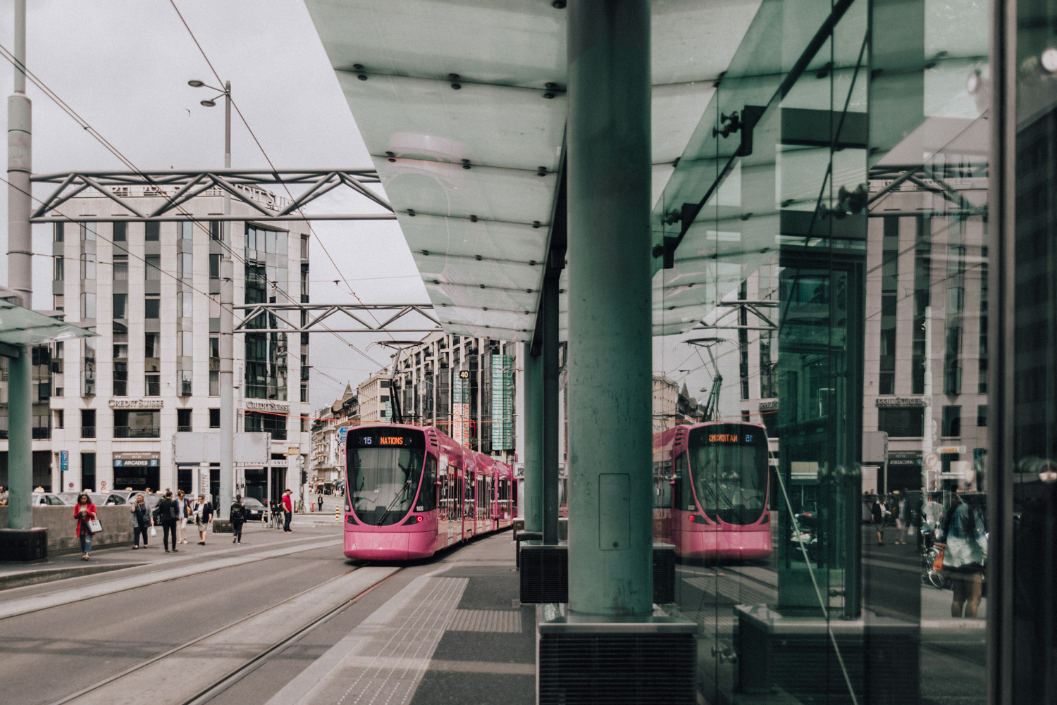 Pink Tram coming in at Geneva Train and Tram Station
