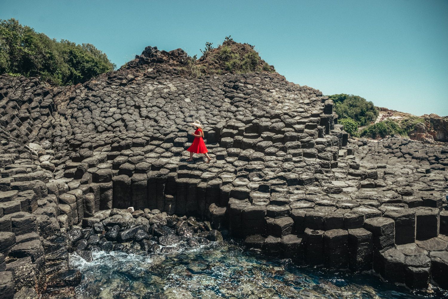 Adaras at Ganh Da Dia in Phu Yen, Vietnam | Girl in Red Dress Walking on basalt rock columns