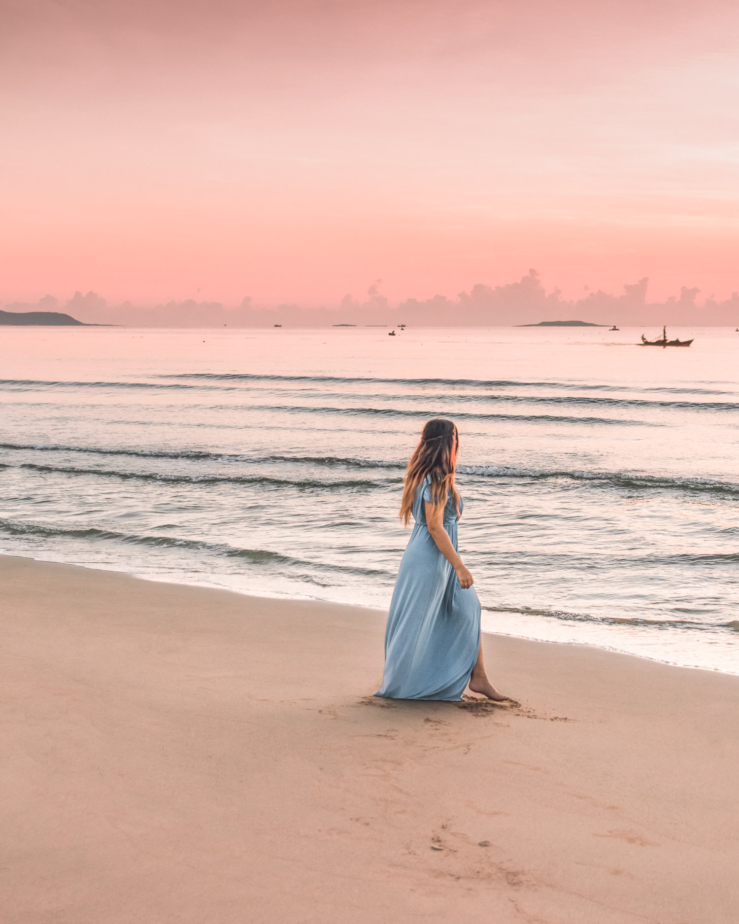 Adaras walking on beach in pink sunrise in Phu Yen, Vietnam