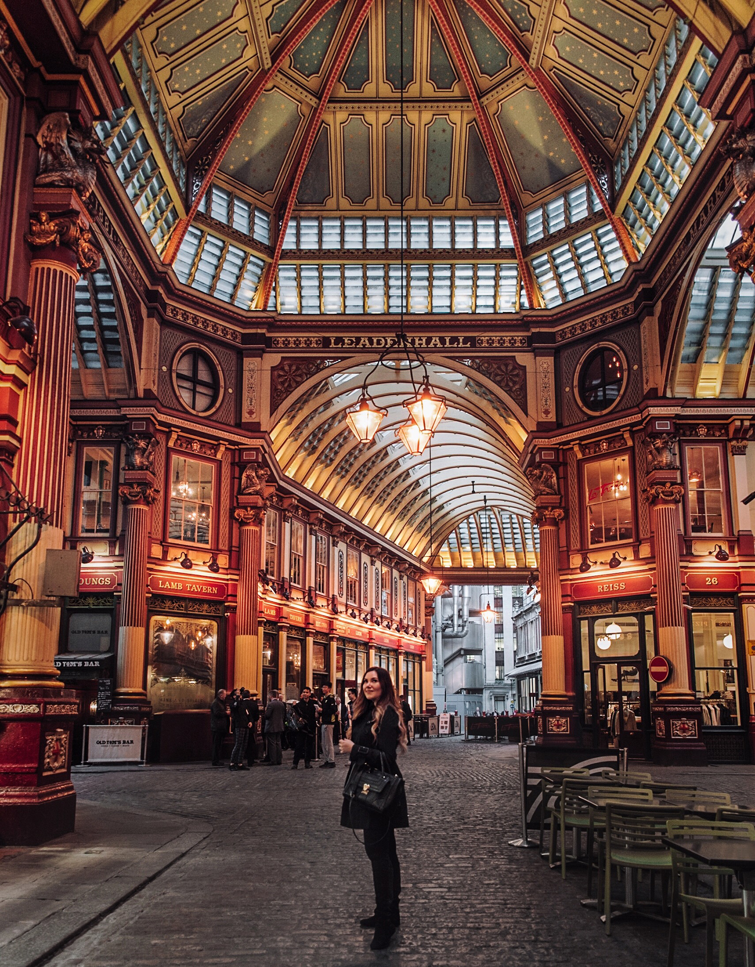 Girl standing in Leadenhall Market in London