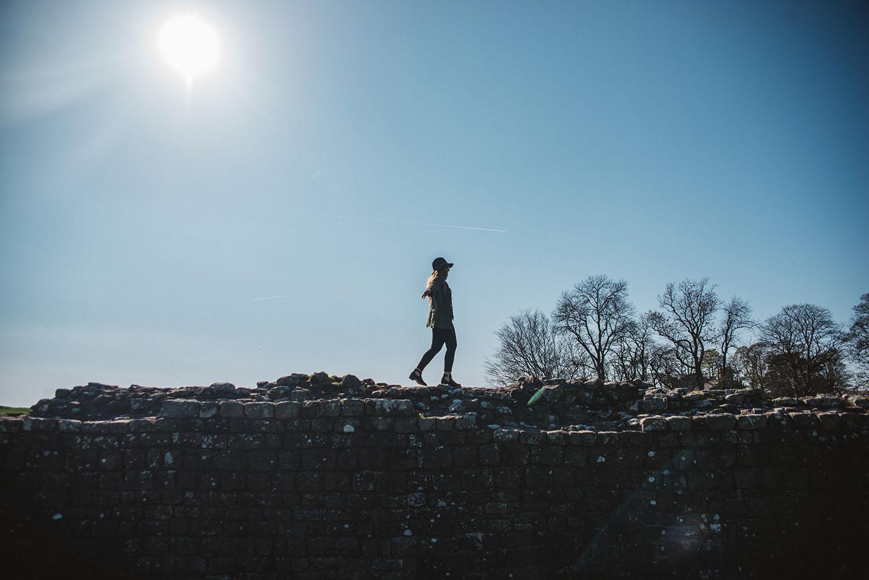 Girl walking on Hadrian's Wall in Cumbria