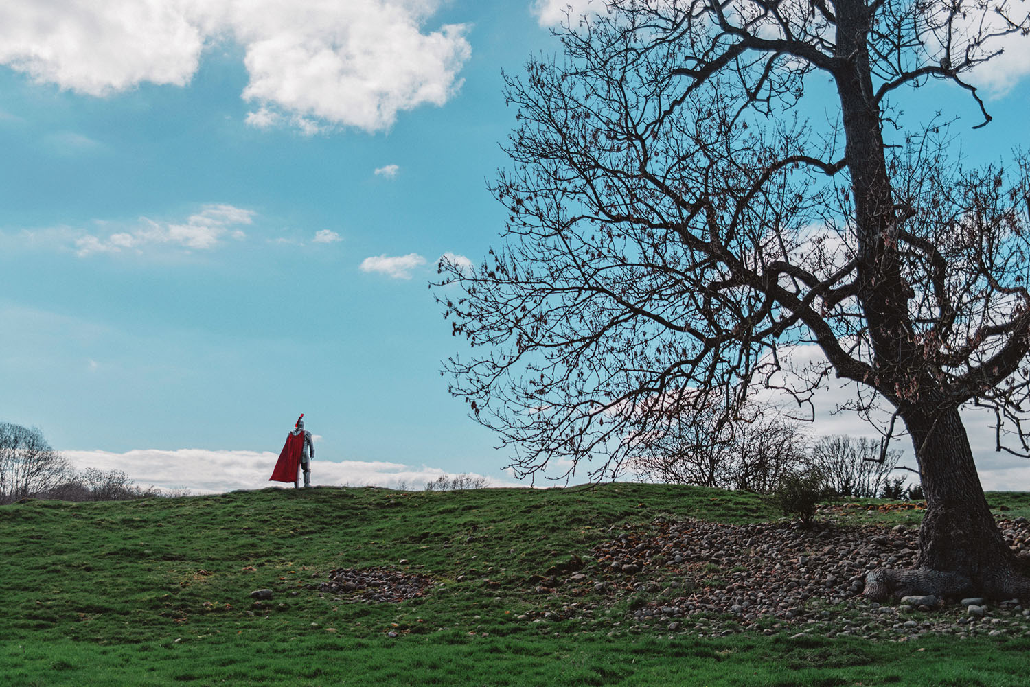 Man in King Arthur costume standing in British landscape - Lake District Tour in Cumbria - Lakes and Legends