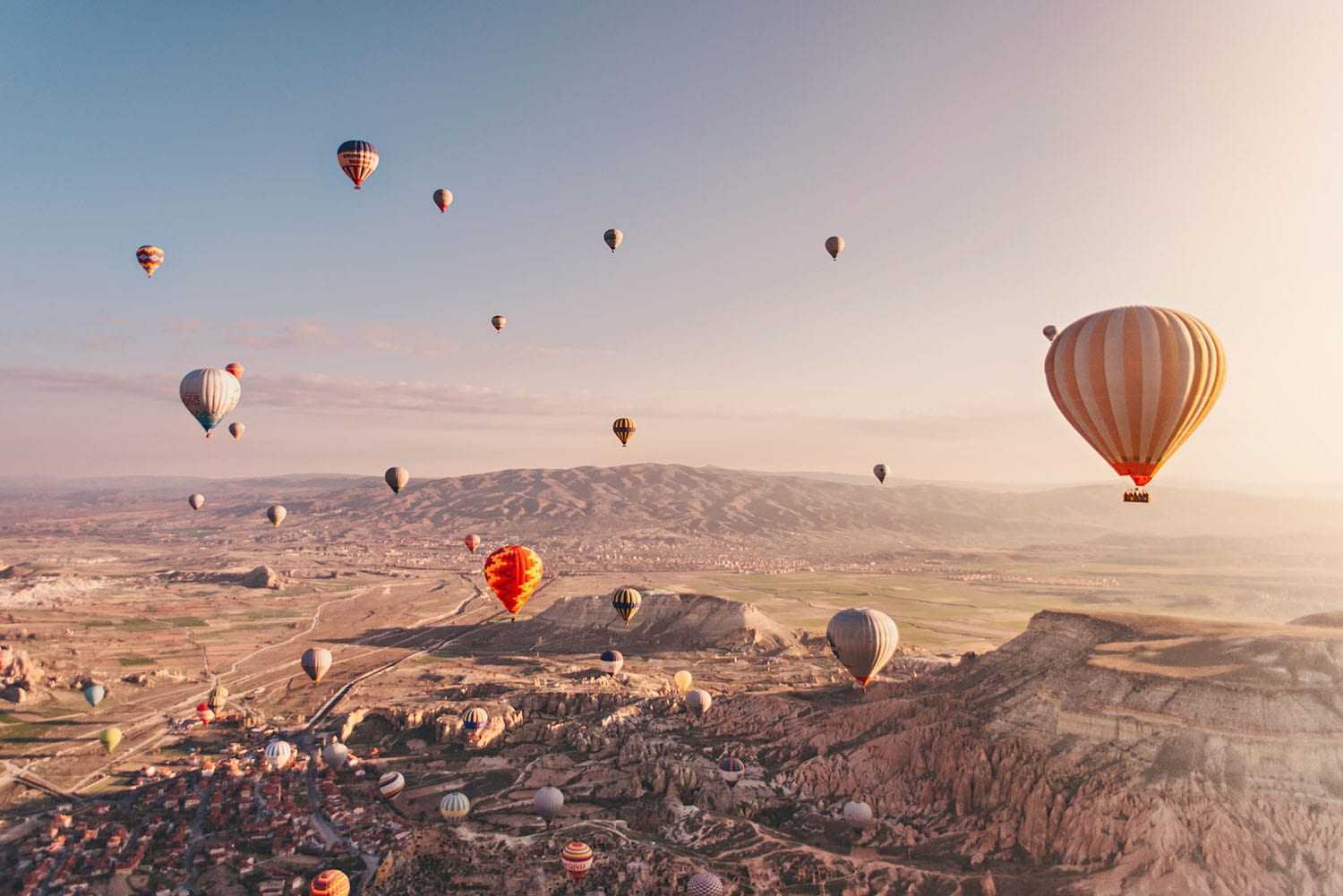 Beautiful sunrise with hot air balloons in Cappadocia, Turkey