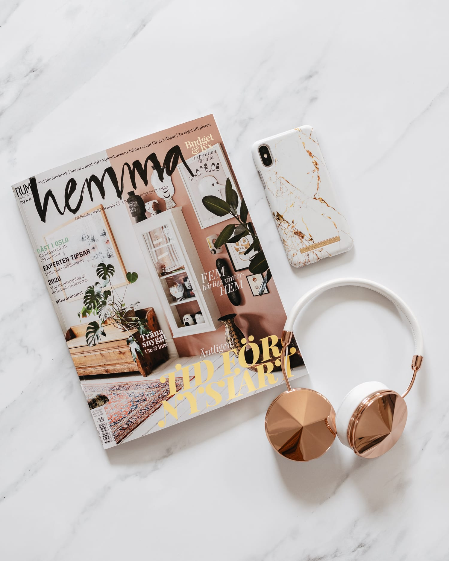 Flatlay with Frends Wireless Headphones & Ideal of Sweden Case