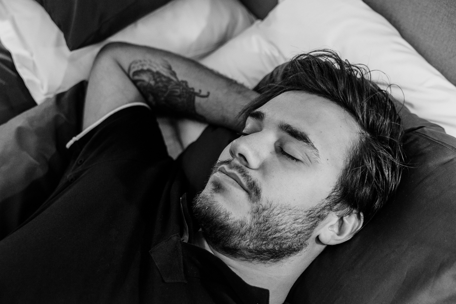 Man Sleeping in Bed - Black and White Photo