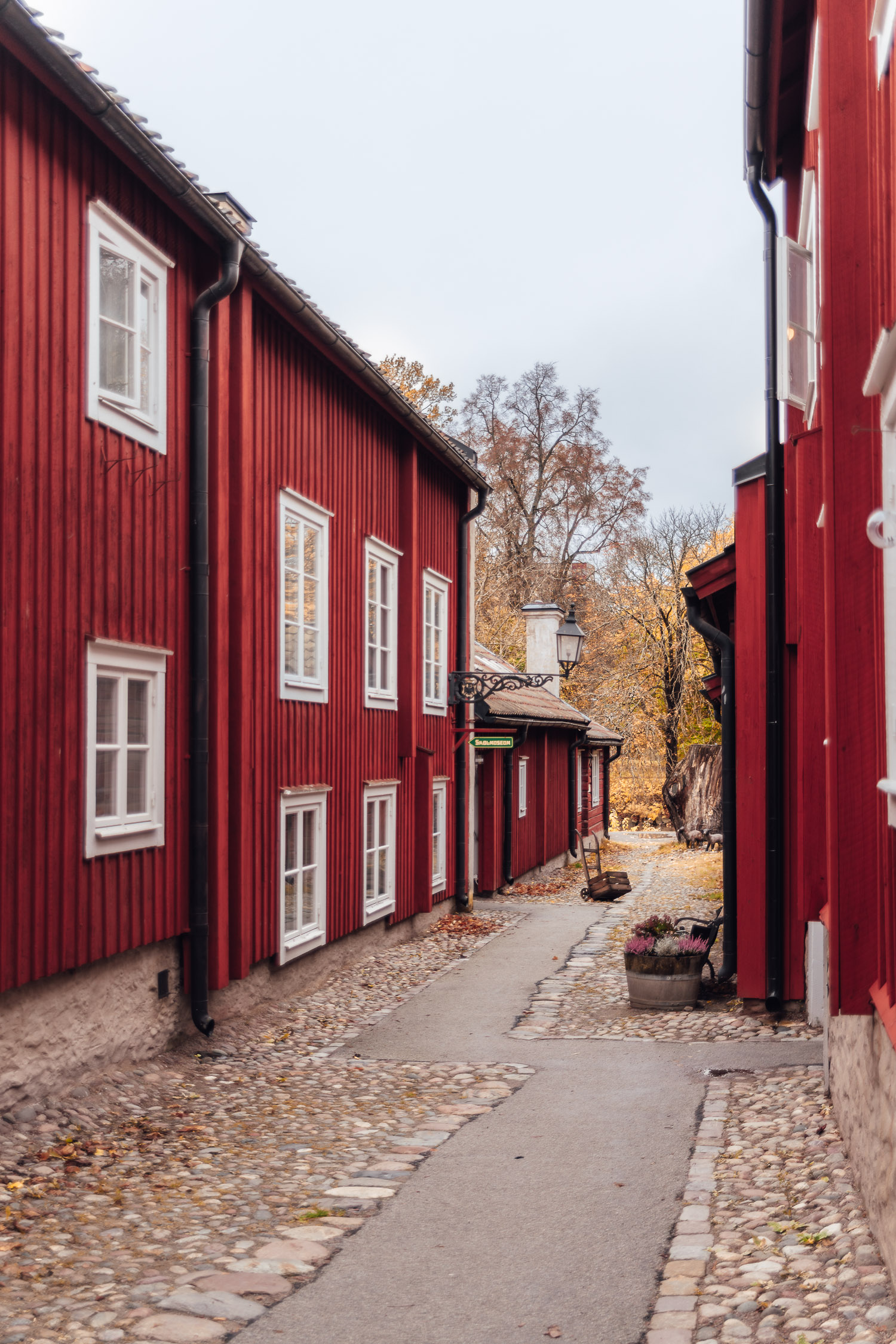 Beautiful street with red buildings in the open-air museum Wadköping, Örebro